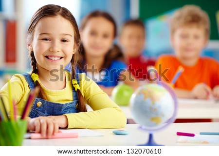 Portrait of an elementary school student with a toothy smile - stock photo