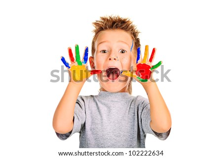 Portrait of an emotional boy enjoying his painting. Education. Isolated over white background. - stock photo