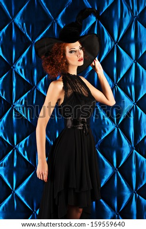 Portrait of an enchanting witch woman, beautiful and glamorous. Halloween.  - stock photo