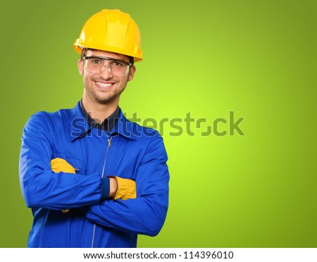 Portrait Of An Engineer On Green Background - stock photo