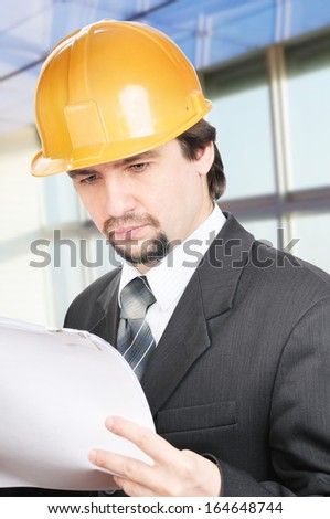 Portrait of an engineer reading a blueprint