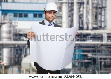 Portrait of an engineer reading a drawing - stock photo