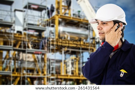 Portrait of an engineer talking on the phone - stock photo