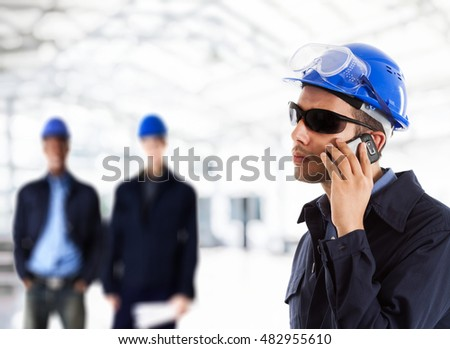Portrait of an engineer talking on the phone