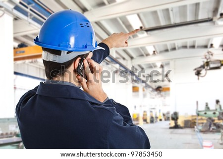 Portrait of an engineer working in a factory - stock photo