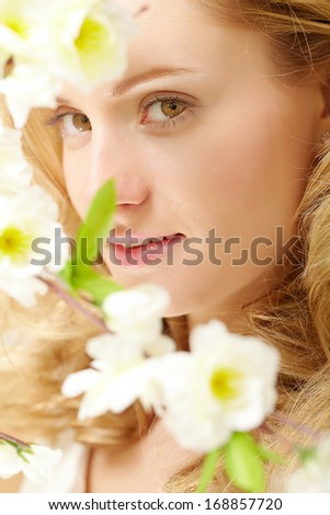 Portrait of an enigmatic lady with white flowers - stock photo