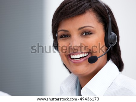 Portrait of an ethnic customer service agent at work in the office - stock photo