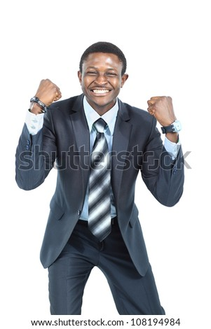 Portrait of an excited businessman with arms raised in success on white background - stock photo