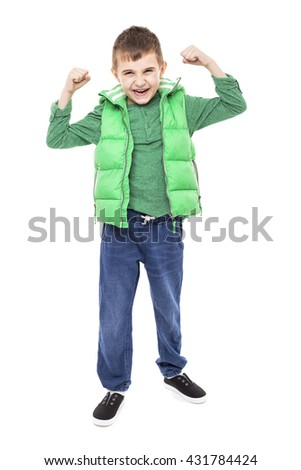Portrait of an excited cute boy with arms up isolated over white background - stock photo