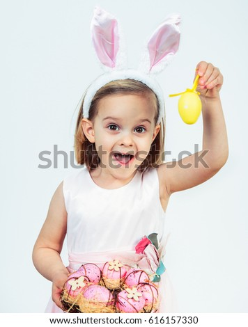 Portrait Of An Excited Easter Kid Holding Egg Decoration