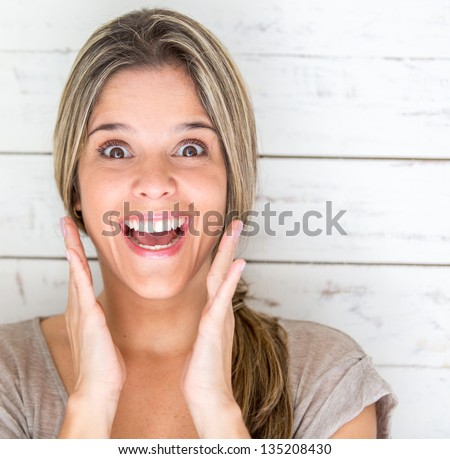 Portrait of an excited woman looking surprised - stock photo