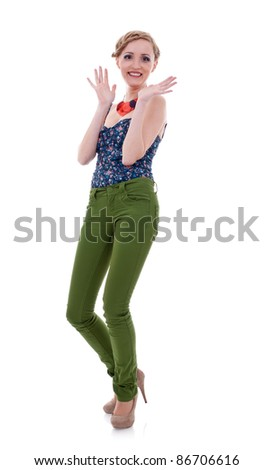 Portrait of an excited young lady celebrating success against white background - stock photo