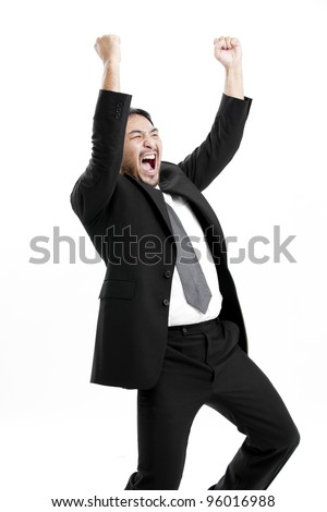 Portrait of an excited young man celebrating success with raised hand against white background