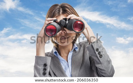 portrait of an executive young woman looking through the binoculars