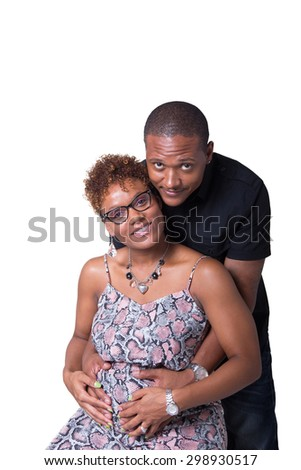Portrait of an expecting African American couple looking at the camera isolated on white