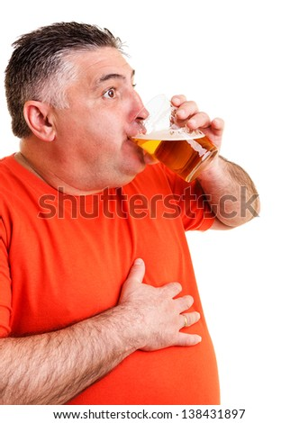 Portrait of an expressive fat man drinking beer isolated on white background