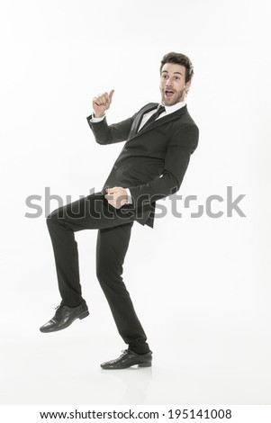 portrait of an expressive young man in suit on isolated background - stock photo