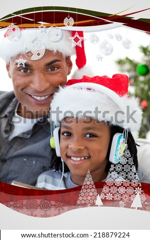 Portrait of an father and son at Christmas time against christmas frame - stock photo