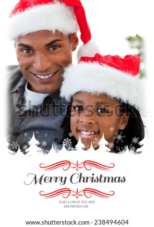 Portrait of an father and son holding a Christmas gift against border - stock photo