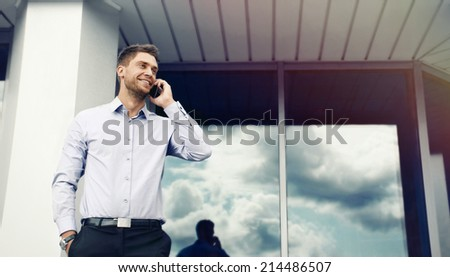 portrait of an handsome attractive businessman on urban building background