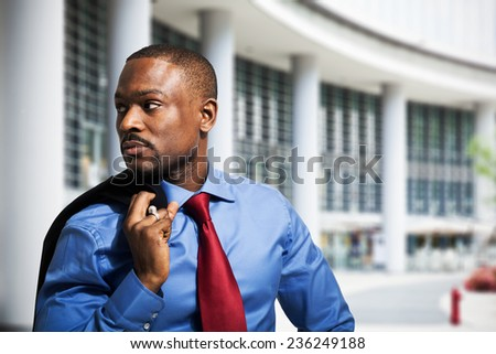 Portrait of an handsome businessman in an urban environment - stock photo