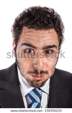portrait of an handsome businessman making a face isolated over a white background