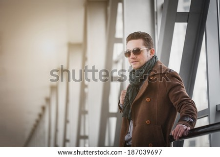 Portrait of an handsome businessman on the modern background
