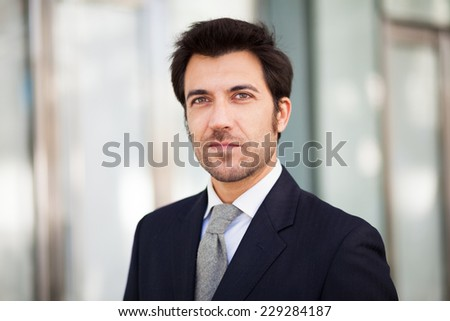 Portrait of an handsome businessman walking outdoors