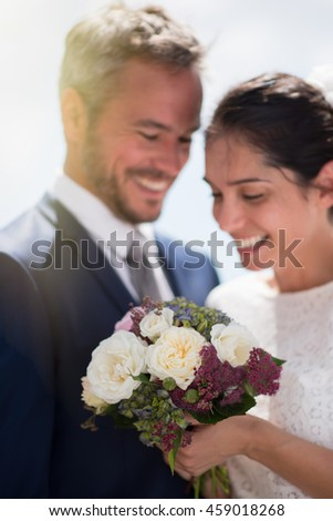Portrait of an handsome couple of newlyweds, smiling after the ceremony