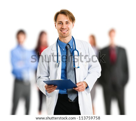 Portrait of an handsome doctor in front of his patients - stock photo