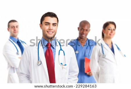 Portrait of an handsome doctor smiling doctor in front of his team