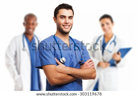 Portrait of an handsome doctor smiling doctor in front of his team - stock photo