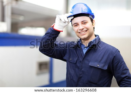 Portrait of an handsome engineer in a factory  - stock photo