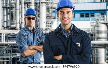 Portrait of an handsome engineer in a factory
