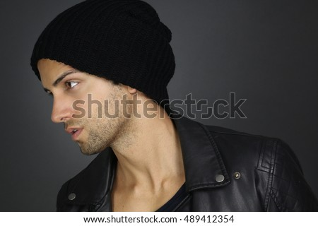 Portrait of an handsome man wearing a hat