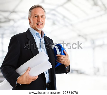 Portrait of an handsome mature engineer - stock photo