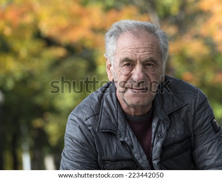 portrait of an handsome old italian man - stock photo