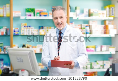 Portrait of an handsome senior pharmacist in his shop