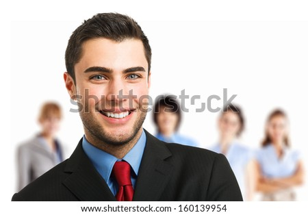Portrait of an handsome smiling executive in front of his team - stock photo