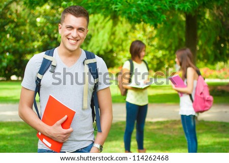 Portrait of an handsome student in a park - stock photo