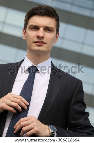 Portrait of an handsome young businessman in an urban setting