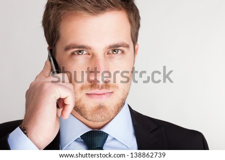 Portrait of an handsome young businessman talking on the phone