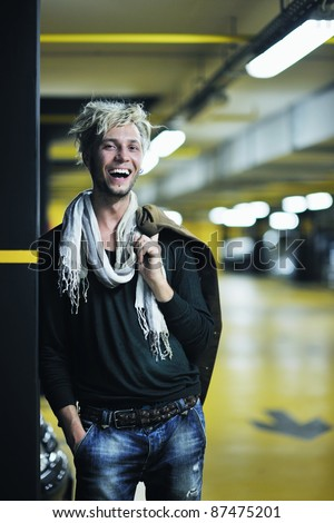 Portrait of an handsome young  man  with urban background and fashion clothes style