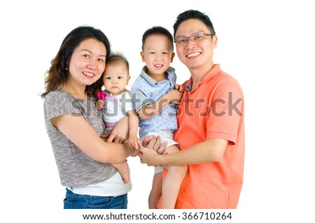 Portrait of an happy asian family - stock photo