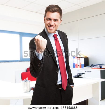 Portrait of an happy businessman - stock photo