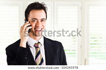 Portrait of an happy businessman talking on the phone - stock photo