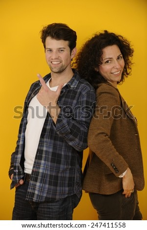portrait of an happy couple on yellow background - stock photo