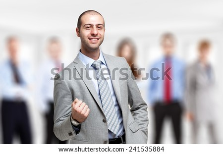 Portrait of an happy man in front of a group of people - stock photo