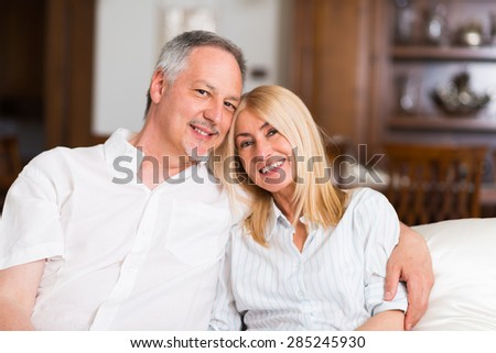 Portrait of an happy mature couple in their home - stock photo