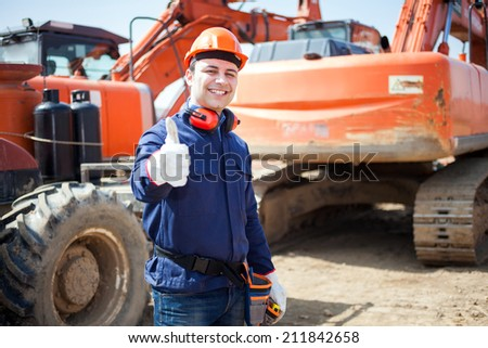 Portrait of  an happy worker in a construction site - stock photo